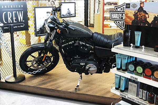 Win a Harley Davidson motorcycle at the American Crew barber corner